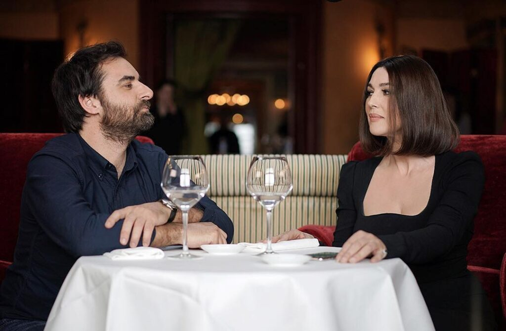 "Monica Bellucci and Grégory Montel in ""Call My Agent."""