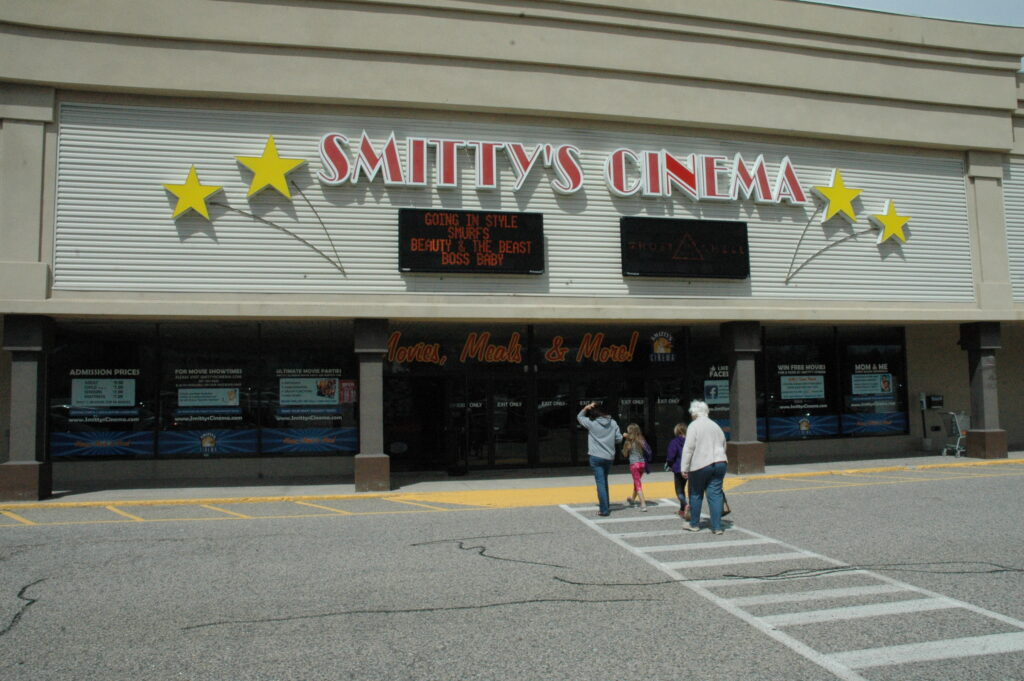 A group goes into Smitty's Cinema in Biddeford on April 18, 2017. The cinema is now shutting down because of the loss of business during the coronavirus pandemic.