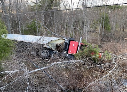 The tractor-trailer that crashed early Monday came to rest about 75 feet from Route 302 on the bank of Dead Lake Stream.