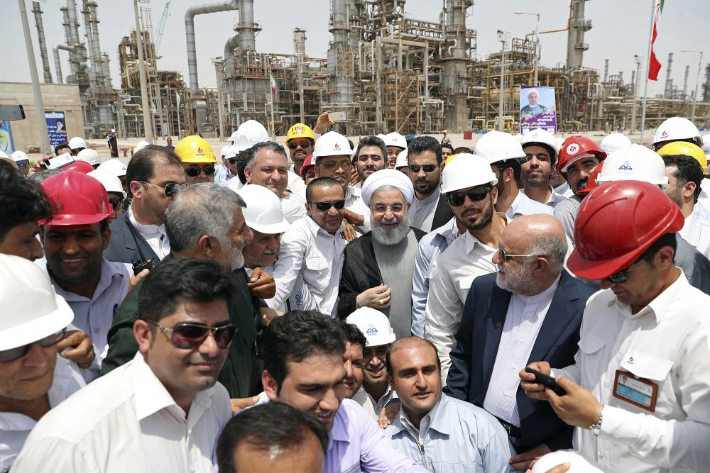 Iranian President Hassan Rouhani, center, inaugurates the Persian Gulf Star Refinery in Bandar Abbas, Iran. Five Iranian tankers likely carrying at least $45.5 million worth of gasoline and similar products are now sailing to Venezuela as of Sunday.