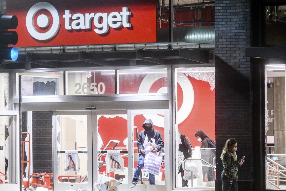 People leave a vandalized Target store in Oakland, Calif., on Saturday, during protests against the death of George Floyd.