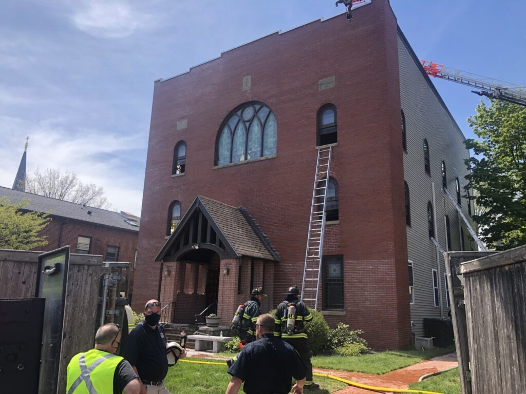 Firefighters work at the building that houses the Etz Chaim congregation and the  Maine Jewish Museum on Congress Street in Portland after a fire was reported there on Thursday.