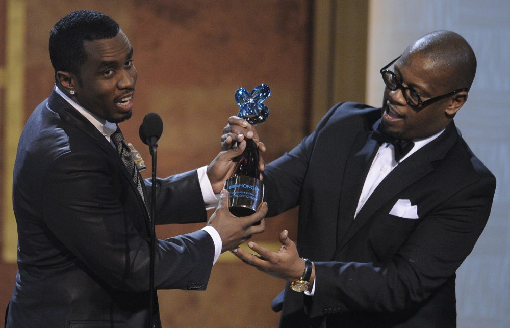 "Media executive Andre Harrell, right, presents an award to Sean ""Diddy"" Combs at the Warner Theatre during the 2010 BET Hip Hop Honors in Washington."