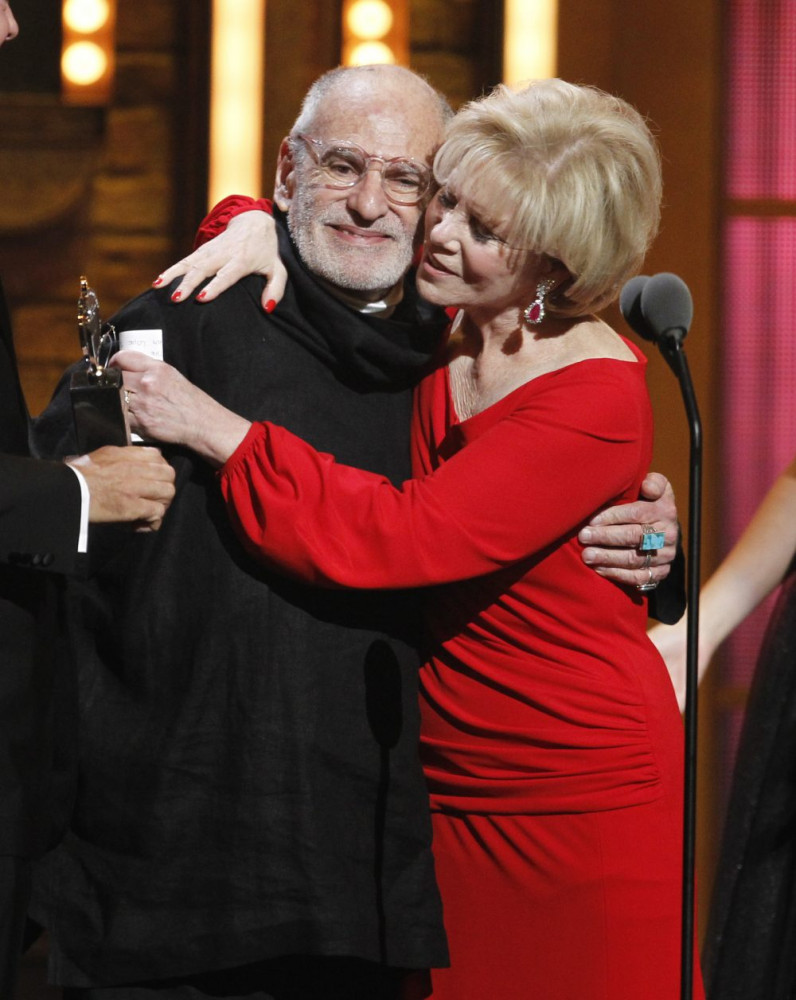 "Larry Kramer and Daryl Roth embrace after they won the Tony Award for Best Revival of a Play for ""The Normal Heart"" during the Tony Awards in New York in 2011."