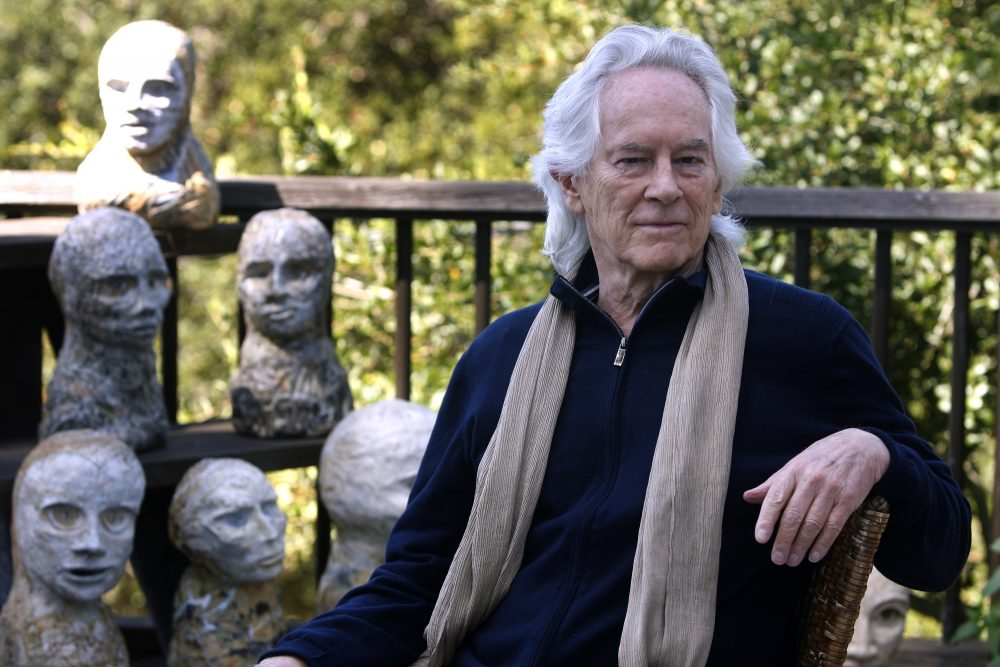 In this Sept. 16, 2010, file photo, beat poet Michael McClure is seen on his deck with sculptures by his wife, artist Amy Evans McClure, at their home in Oakland, Calif.