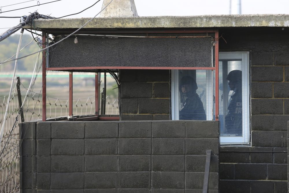 Army soldiers stand guard inside a military guard post in Paju, South Korea, near the border with North Korea. North and South Korean troops exchanged fire along their tense border on Sunday, the South's military said, blaming North Korean soldiers for targeting a guard post.
