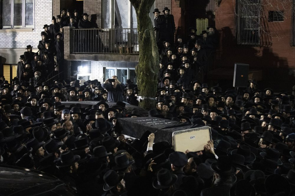 Orthodox Jewish men carry Moshe Deutsch's casket outside a Brooklyn synagogue Dec. 11 following his funeral in New York. Deutsch was killed in a shooting inside a Jersey City, N.J., kosher food market. Authorities said the attackers, David Anderson and Francine Graham, were motivated by a hatred of Jewish people and law enforcement.