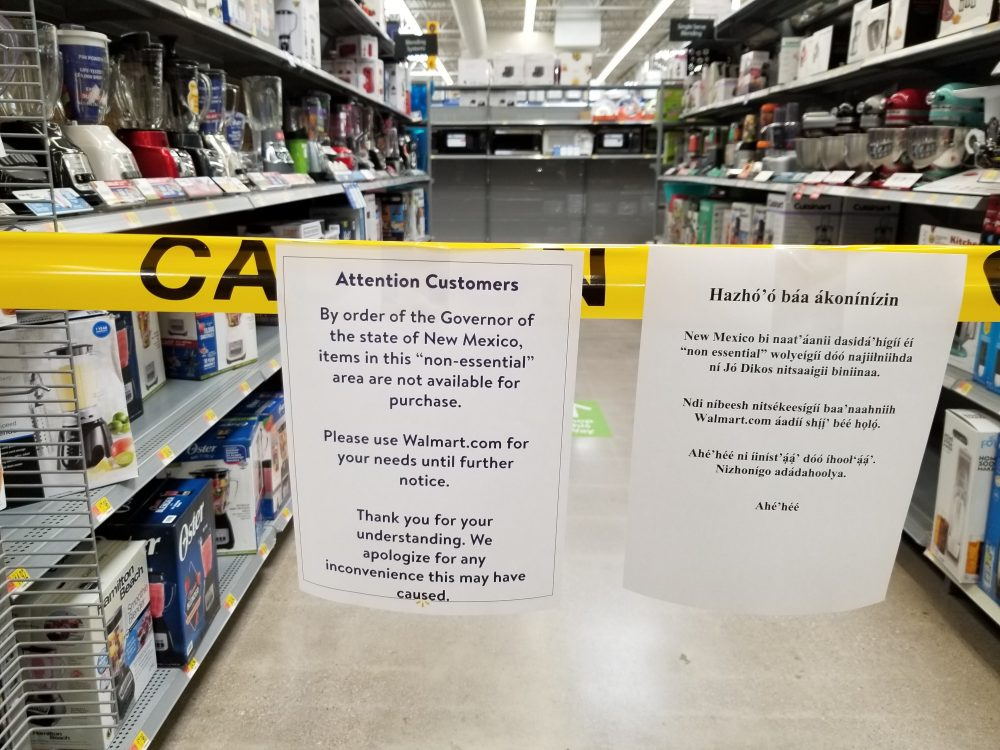 Signs inside the Walmart in Gallup, N.M., to advise shoppers that non-essential items aren't available for purchase on Friday.
