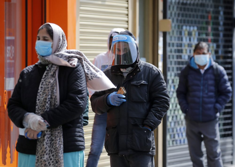 People queue at a post office during the coronavirus lockdown in London on Tuesday. While a few European countries relax the COVID-19 lockdown, Britain remains under lockdown without an exit strategy yet.