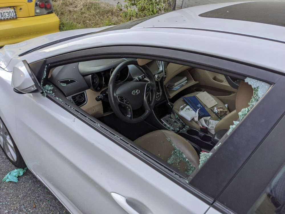 A parked car's driver side window was broken after a smash-and-grab break-in in Los Angeles. With more people than ever staying home to lessen the spread of COVID-19, their vehicles are parked unattended on the streets, making them easy targets.