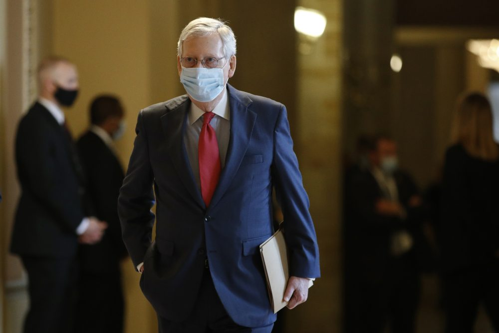 Senate Majority Leader Mitch McConnell walks to the Senate chamber after meeting with Vice President Pence and Treasury Secretary Steve Mnuchin on Tuesday.