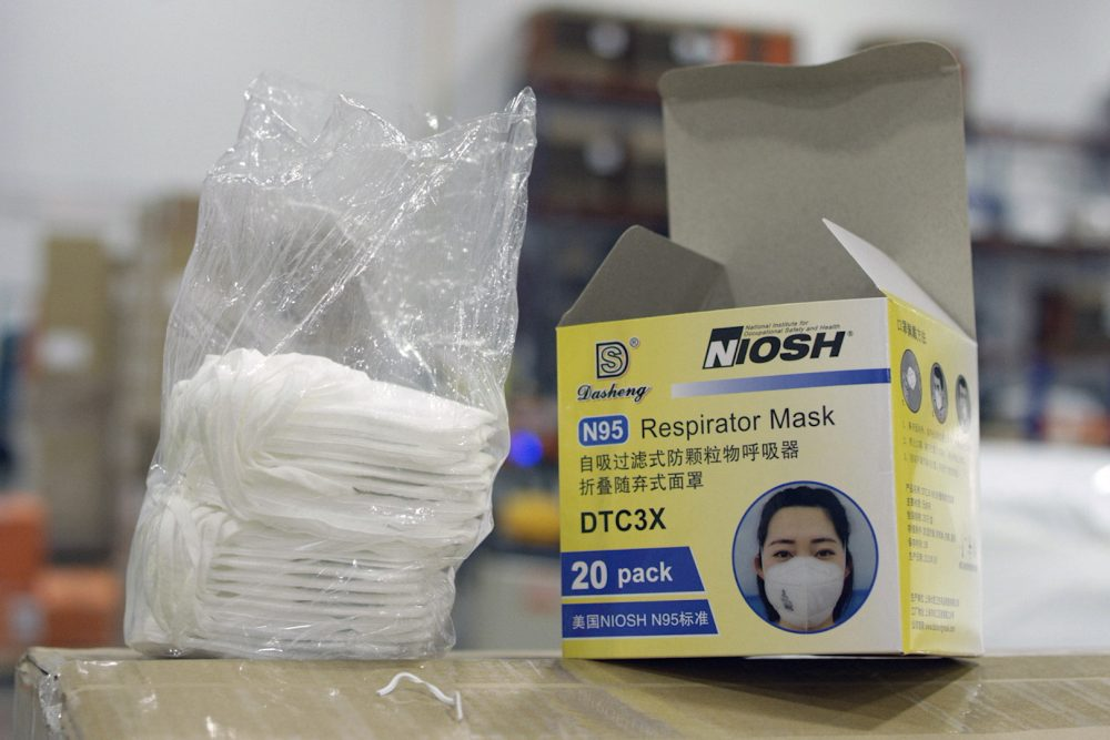An opened box of protective masks sits on a pallet at Direct Relief's distribution center in Santa Barbara, Calif.  An Associated Press investigation has found millions of medical masks, gloves, gowns and other supplies being used in hospitals across the country are counterfeits.