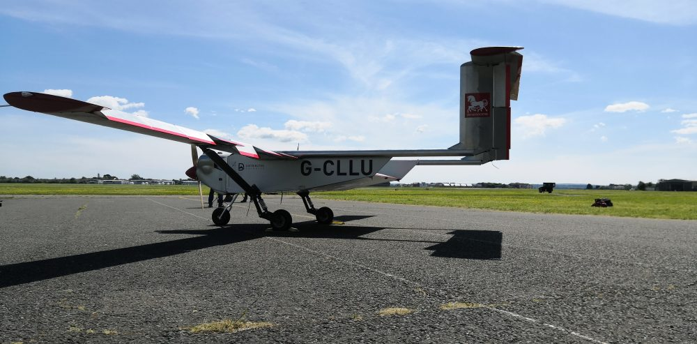 """The """"Wingracers ULTRA"""" drone parked  at Solent Airport in Lee-on-the-Solent, England. Britain is testing the use of a car-sized drone to deliver medical supplies more quickly to hospitals and help ease pressure on the country's health system during the new coronavirus crisis."""
