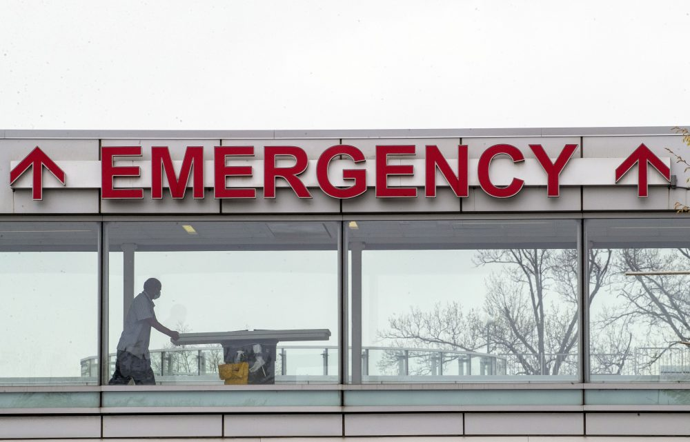 A medic moves a gurney April 20 at Queens Hospital Center in the Jamaica neighborhood of the Queens borough of New York.