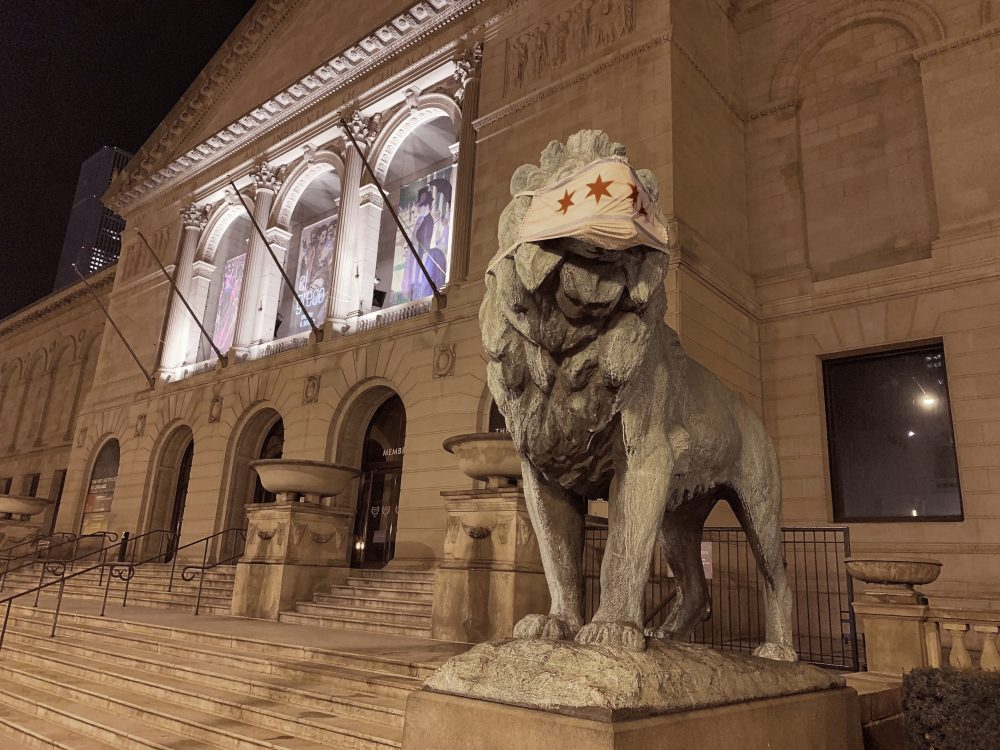 A lion statue with a mask Friday at the Art Institute of Chicago. A face mask adorning one of the iconic lion statues at the entrance of the Art Institute of Chicago was stolen Thursday, less than 24 hours after the symbolic masks were applied. By Friday afternoon, the mask had been replaced and both lion statues were once again sporting the protective gear.