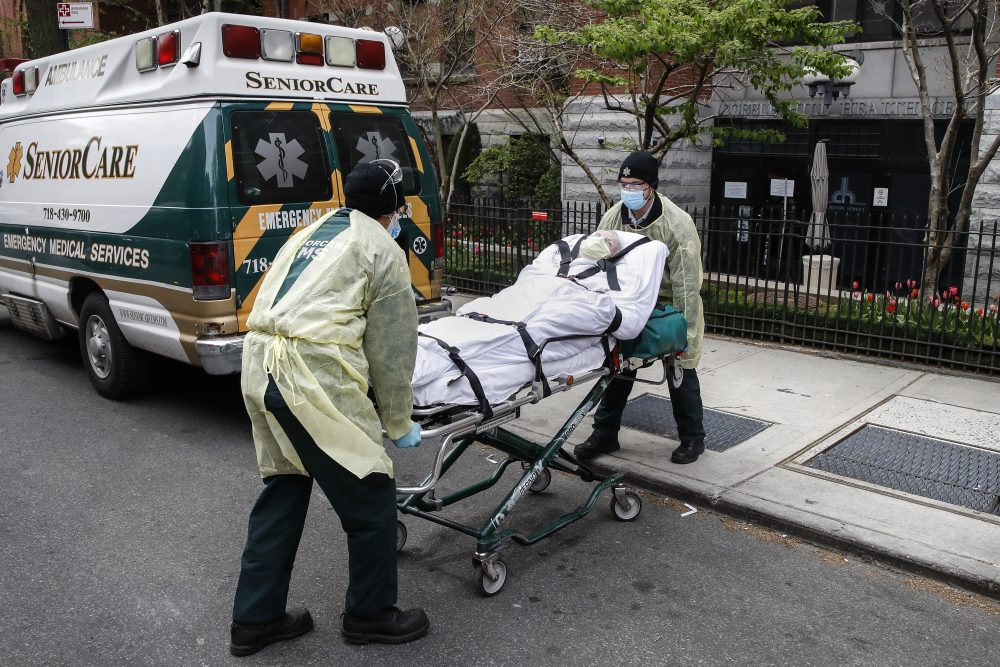 A patient is loaded into the back of an ambulance by emergency medical workers outside Cobble Hill Health Center on April 17 in the Brooklyn borough of New York. The despair wrought on nursing homes by the coronavirus was laid bare Friday in a state survey identifying numerous New York facilities where multiple patients have died. Nineteen of the state's nursing homes have each had at least 20 deaths linked to the pandemic. Cobble Hill Health Center was listed as having 55 deaths.