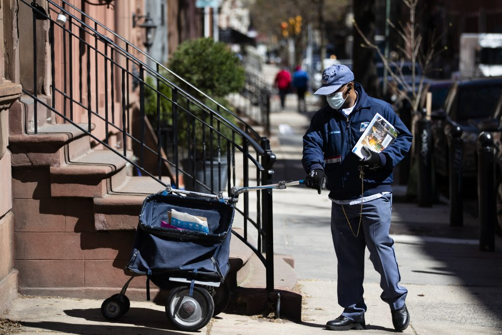 A United States Postal worker makes a delivery in Philadelphia. Polls show that Americans overwhelmingly support federal government funding to help the Postal Service survive the pandemic.