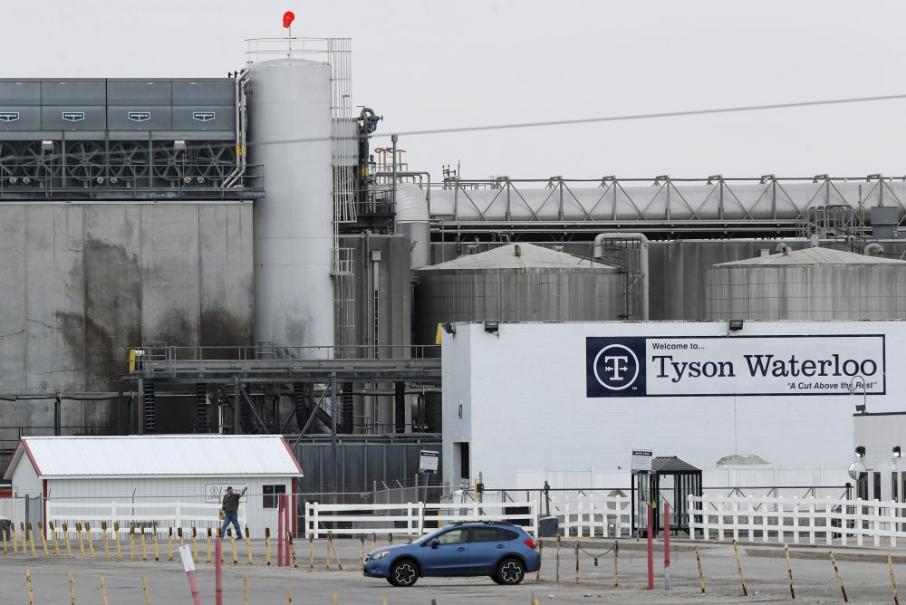A worker leaves the Tyson Foods plant in Waterloo, Iowa in May.