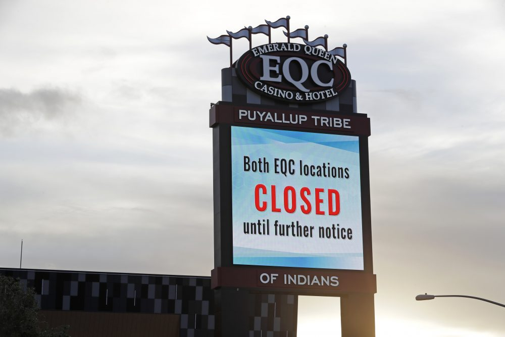 A sign indicates that the new Emerald Queen Casino in Tacoma, Wash., which is owned by the Puyallup Tribe of Indians, is closed. Hundreds of tribal casinos across the country have voluntarily closed because of the pandemic, in many cases taking away a tribe's primary source of revenue used to operate tribal government and social programs.