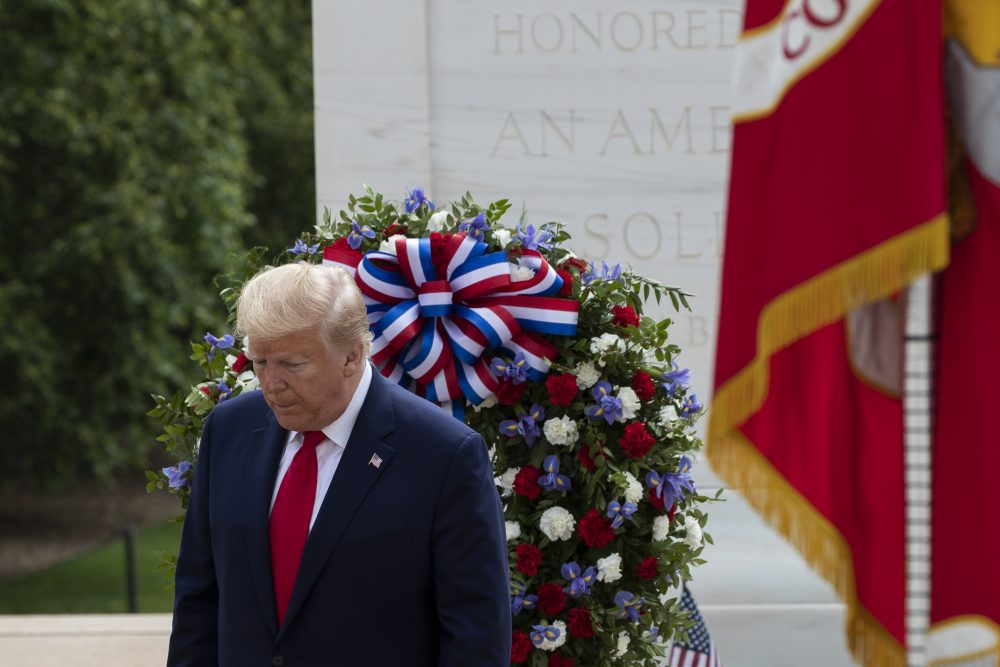 President Trump turns after saluting the Tomb of the Unknown Soldier on Monday in Arlington National Cemetery.
