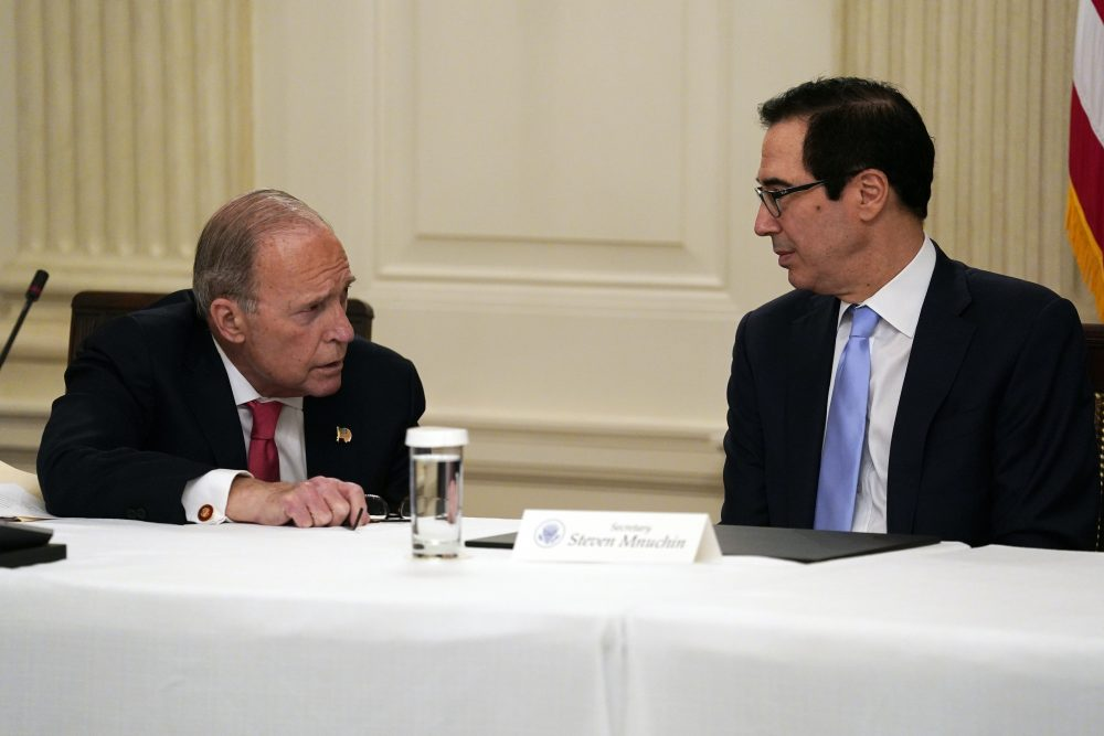 Treasury Secretary Steven Mnuchin, right, talks with White House chief economic adviser Larry Kudlow prior to a meeting Friday between President Trump and Republican lawmakers in the State Dining Room of the White House in Washington.