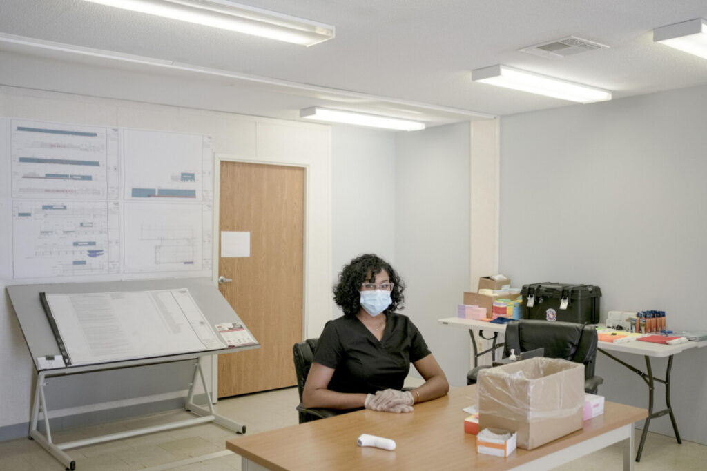 Simone Williams works as a thermal scanner in Urbana, Maryland. She helps screen about 100 construction workers for signs of the virus. She checks their temperature with a thermal scanner and asks questions about their health before clearing them to enter.