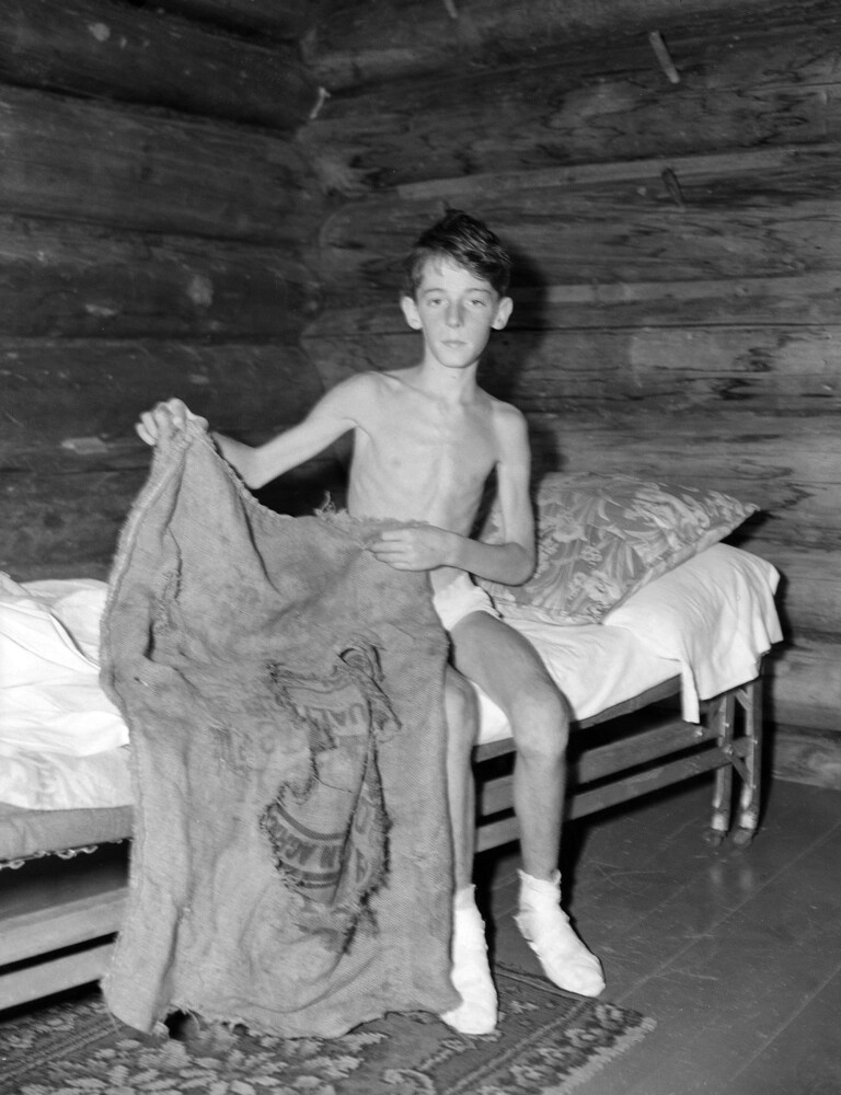Donn Fendler shows the sack which he used as a sleeping bag while he wandered for eight days in the wilds of Maine in July 1939.