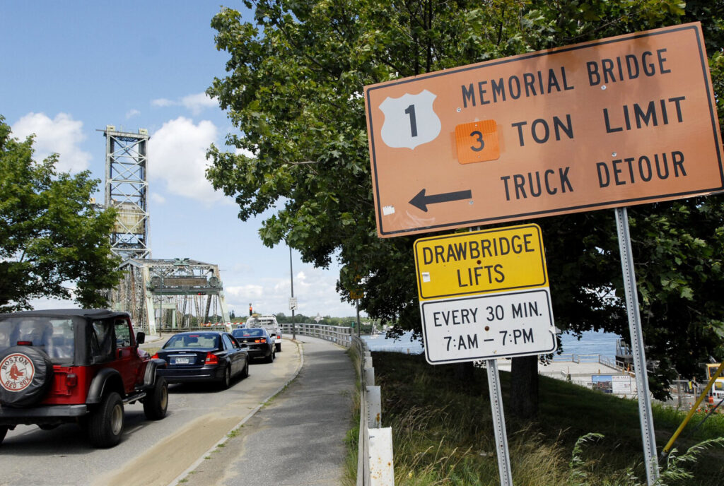 Vehicles wait to cross Memorial Bridge in New Hampshire where the bridge is posted as having a 3 Ton Limit on July 22, 2010.