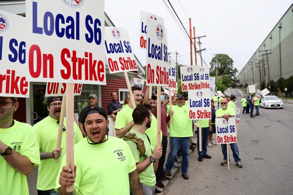 Members of Local S6 of the Machinists Union, which represents 4,300 of BIW's 6,700 employees, march on strike Monday, June 22,in Bath.