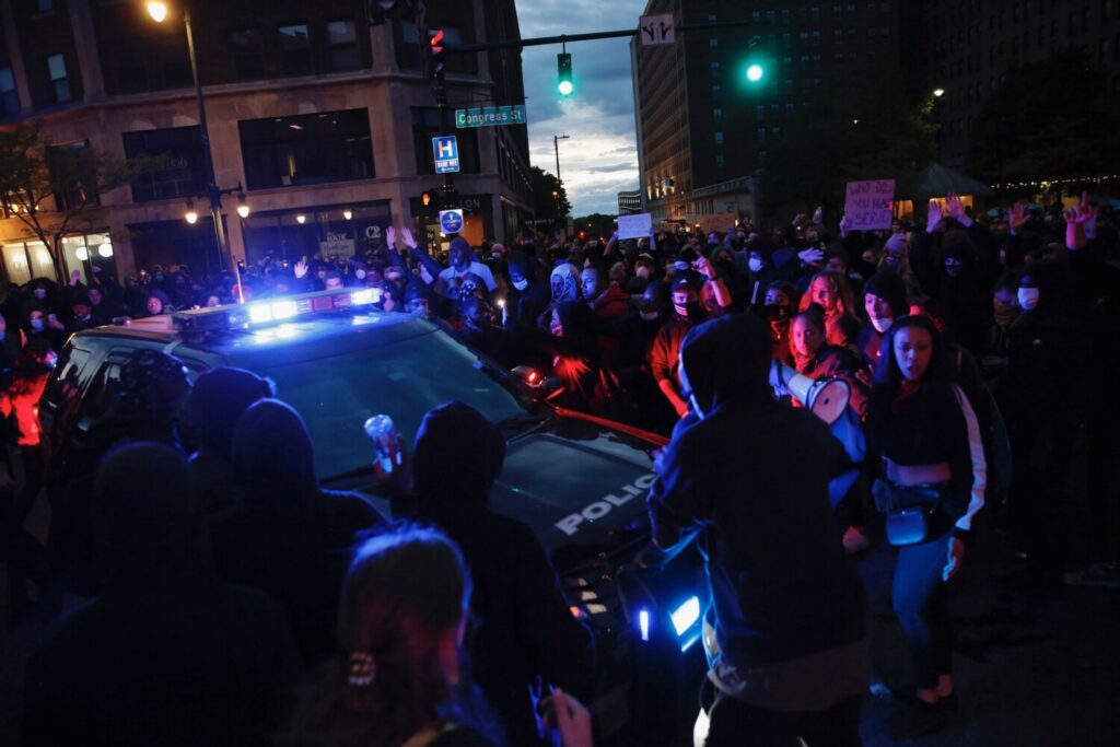 Protesters surround a Portland police cruiser on the night of June 1 as a protest that drew an estimated 2,500 people gets tense.