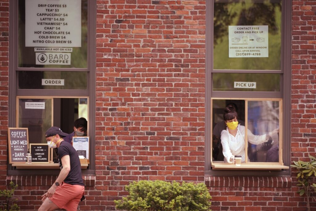 Experts say when you buy a $3 cup of coffee from your favorite coffee shop, such as Bard Coffee shown here with its new takeout windows, you should throw in an extra dollar as a tip.