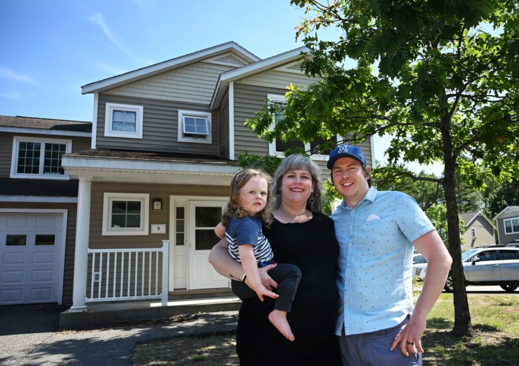 Oisin Cavanaugh, 2, Aoife O'Brien and her husband, Chris Cavanaugh, stand outside their Brunswick home on Monday. The family searched more than a year for a home before buying one.