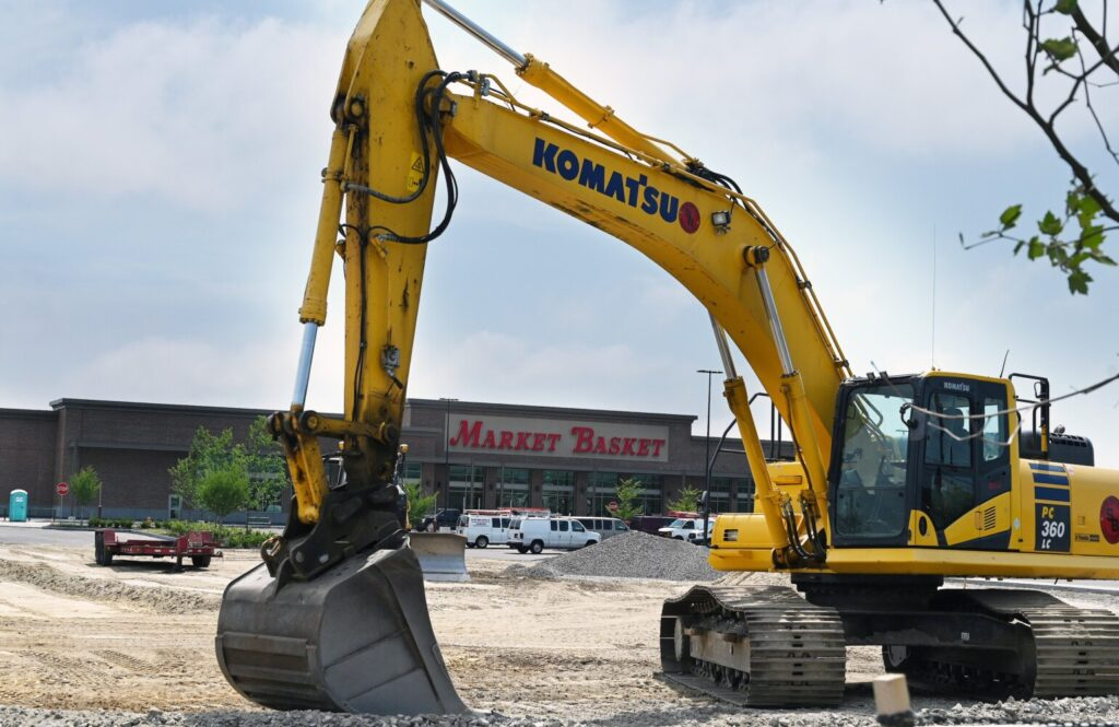 A backhoe at Rock Row sits near Market Basket in Westbrook Tuesday. The Massachusetts-based supermarket chain is hiring workers for its upcoming location, which will be its second in Maine.