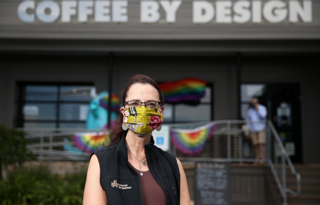 Mary Allen Lindemann, co-owner of Coffee By Design, stands in front of the local chain's Diamond Street location in Portland. Retailers throughout the state have encountered patrons who've expressed anger, hostility and a refusal to follow restrictions designed to prevent community spread of the coronavirus.