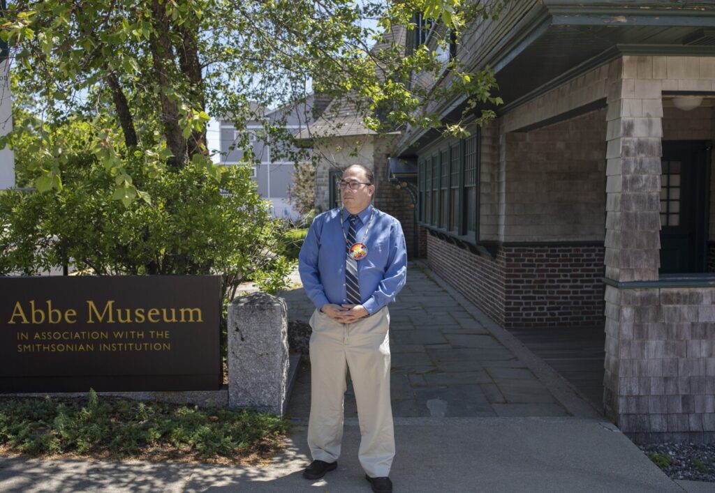 Chris Newell, executive director and senior partner to Wabanaki Nations at the Abbe Museum, poses for a portrait at the museum in downtown Bar Harbor in June 2020. Newell, a citizen of the Passamaquoddy Tribe at Indian Township, has resigned for personal reasons.
