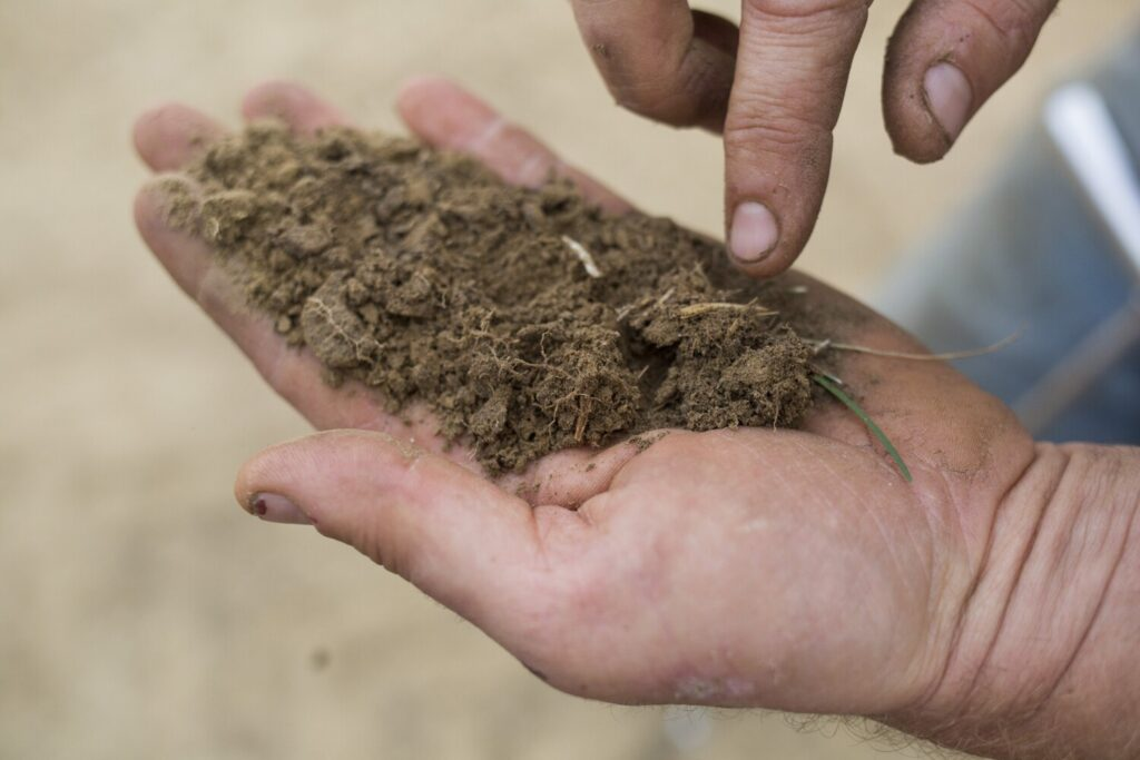 Segments of Maine, including Cumberland and York counties last experienced a drought in 2016 when this photo was shot. A small rancher held a parched soil sample from his land in Durham. The entire six inches of soil was like powder.