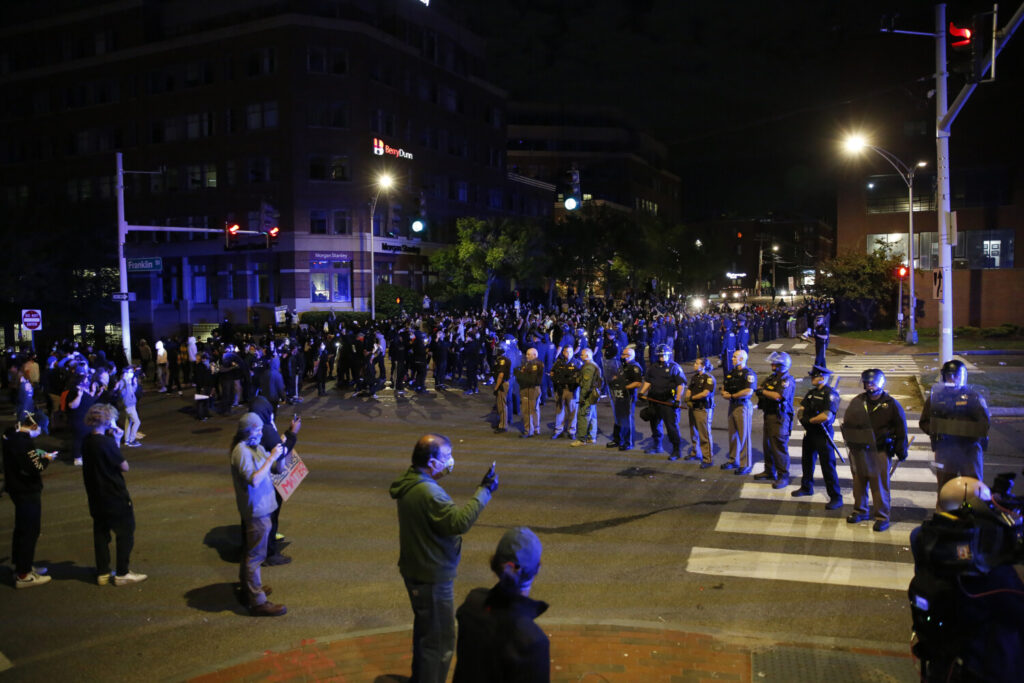 Portland police and protesters face off at the intersection of Franklin and Middle streets on June 1, 2020.