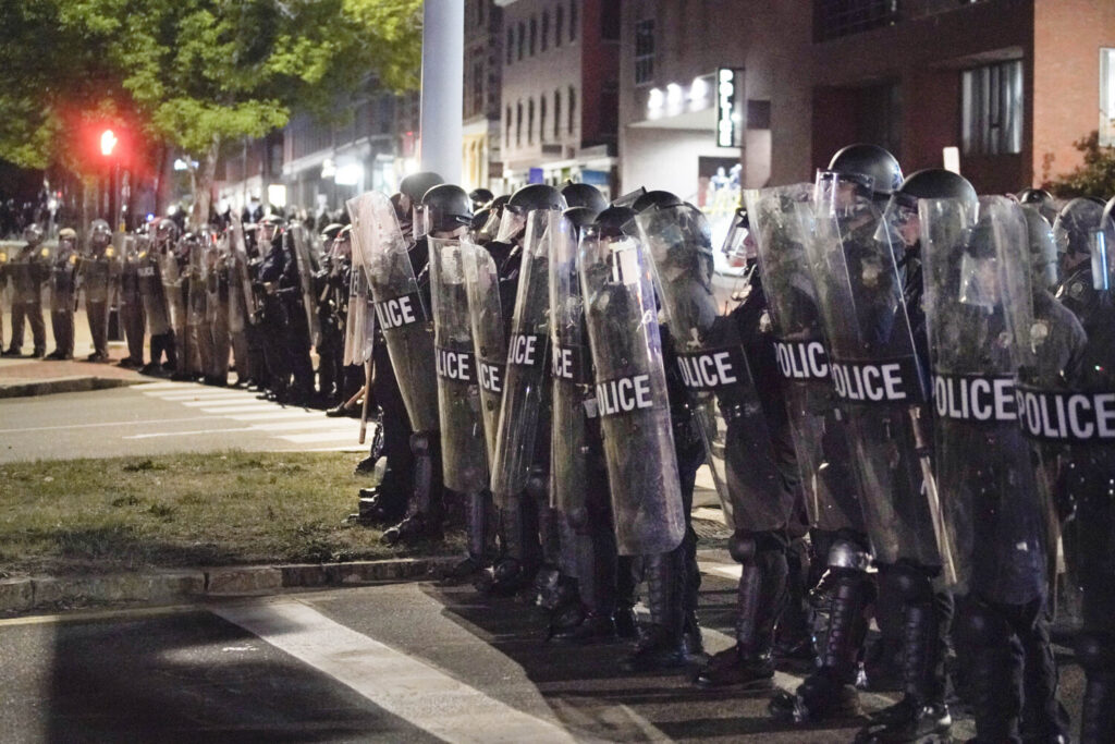 Police in riot gear form a line across Franklin Street in Portland early in the morning on June 2 during a protest against police brutality and racism.