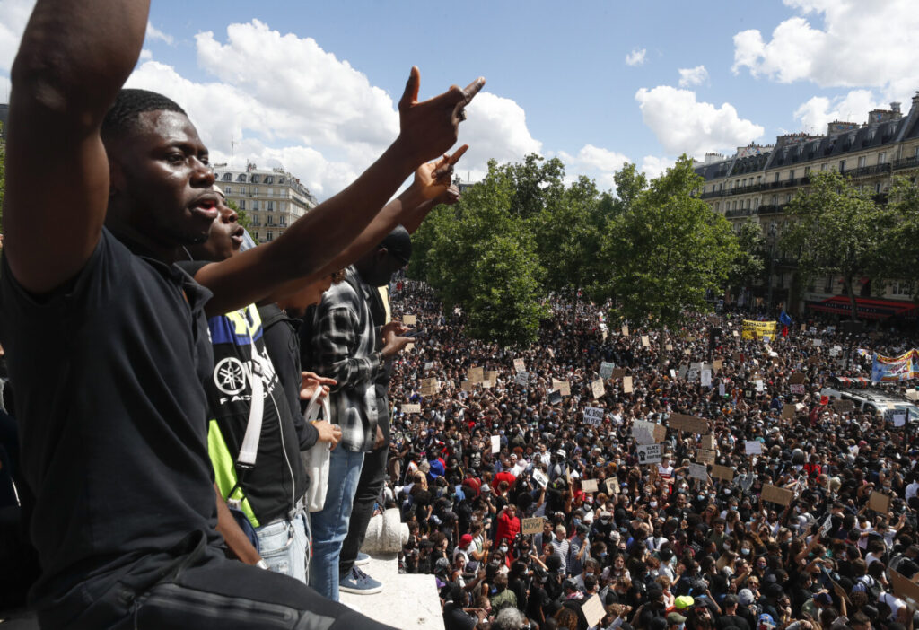 Thousands of people take part in a march against police brutality and racism in Paris on Saturday.