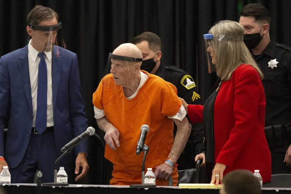 Joseph James DeAngelo Jr., center, charged with being the Golden State Killer, is helped up by his attorney, Diane Howard, as Sacramento Superior Court Judge Michael Bowman enters the courtroom in Sacramento, Calif., on Monday. DeAngelo pleaded guilty to multiple counts of murder and other charges 40 years after a sadistic series of assaults and slayings in California.