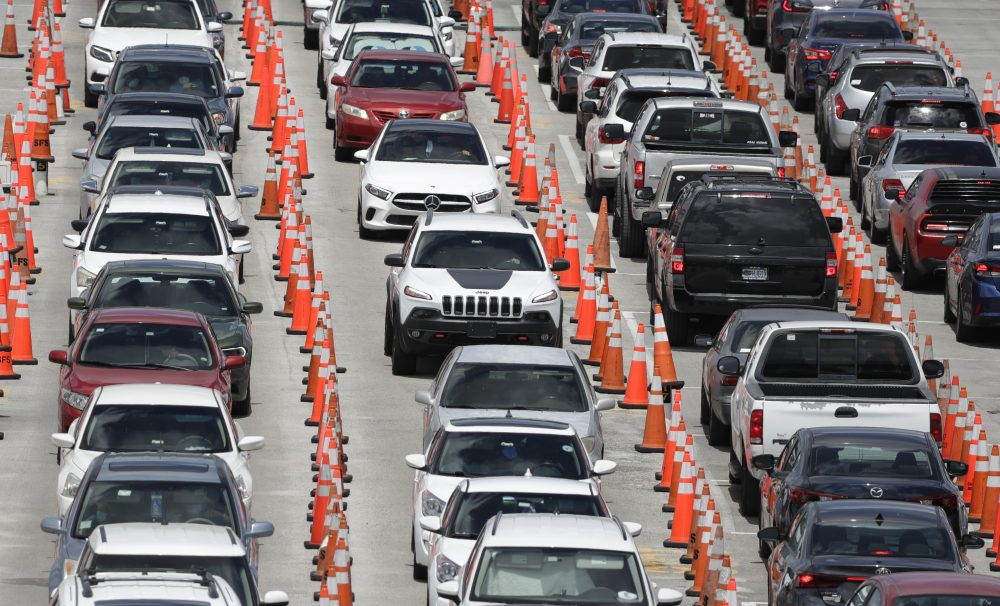 Lines of cars wait at a coronavirus testing site outside of Hard Rock Stadium on Friday in Miami Gardens, Fla.