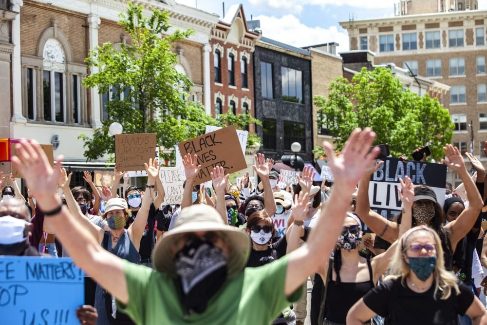 Protesters in Iowa City, Iowa, protest against police brutality and systemic racism on May 30.