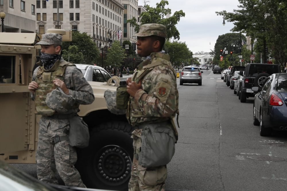 Members of the D.C. National Guard block an intersection on 16th Street as demonstrators gather to protest the death of George Floyd on Tuesday near the White House.