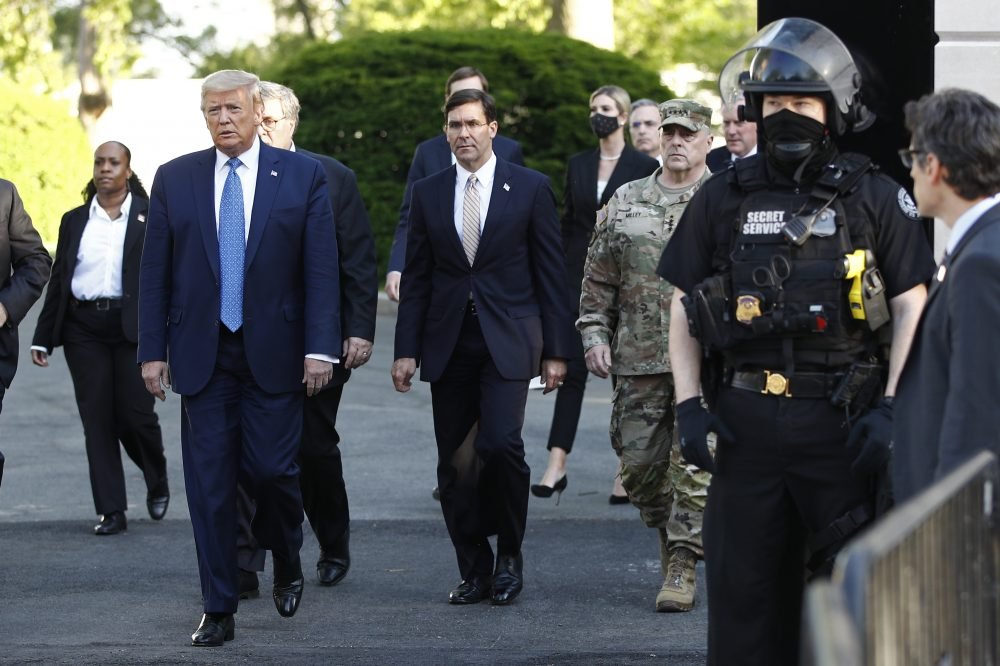 President Trump, followed by Defense Secretary Mark Esper, leaves the White House on Monday to visit outside St. John's Church in Washington, after having protesters cleared from nearby Lafayette Park.