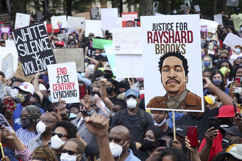 A crowd of demonstrators march to the Capitol on Monday in Atlanta. Rayshard Brooks, 27, was shot and killed by police Friday night.