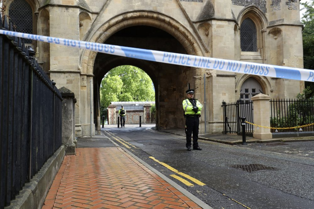 Police stand guard at the Abbey gateway of Forbury Gardens park in Reading following Saturday's stabbing attack in the gardens. Thames Valley Police said a 25-year-old man from the town has been arrested and they are not looking for anyone else.