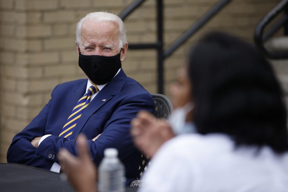 Presumptive Democratic presidential nominee and former Vice President Joe Biden listens as Carlette Brooks, owner of Carlette's Hideaway, a soul food restaurant, talks during a meeting with small business owners on June 17 in Yeadon, Pa.