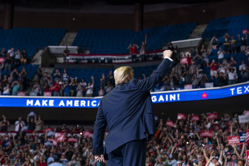 President Trump arrives at a campaign rally at the BOK Center on Saturday in Tulsa, Okla. The city's fire department spokesperson fire marshal's office reported a crowd of just less than 6,200 in the arena after Tulsa officials had expected a crowd of 100,000.