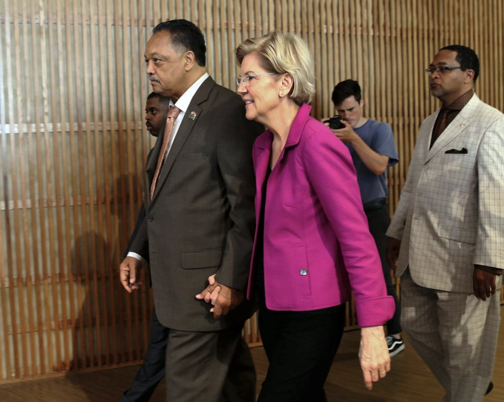 The Rev. Jesse Jackson walks with Sen. Elizabeth Warren, D-Mass., in June 2019. (Kevin Tanaka/Chicago Sun-Times via AP, File)