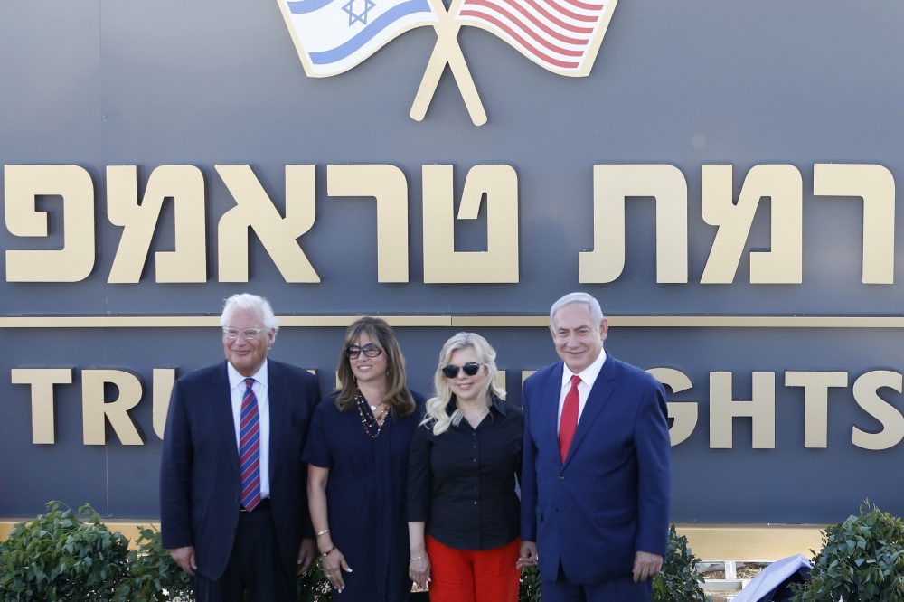 Israeli Prime Minister Benjamin Netanyahu, right, his wife Sara, United States Ambassador to Israel David Friedman, left, and his wife Tammy  during the inauguration of a new settlement named after President Trump in the Golan Heights, on June 16, 2019. An Israeli cabinet minister said the government approved the settlement plans.